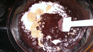 dry ingredients into melted chocolate.