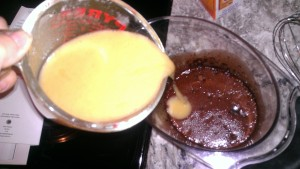 pour applesauce/egg mixture into honey/cocoa mixture