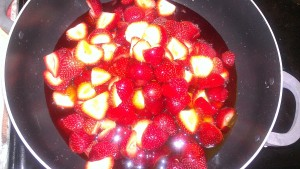 strawberries and honey in pot