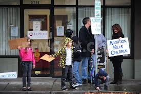 protestors outside a clinic