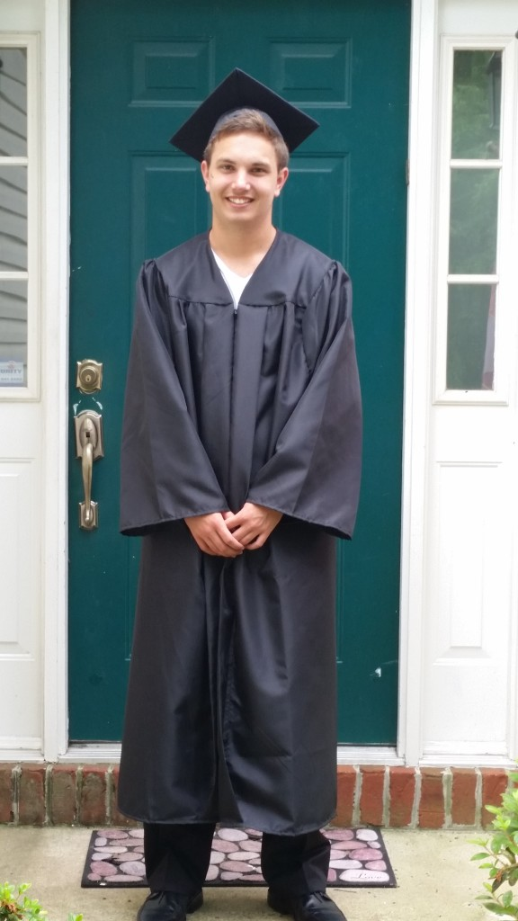In grad attire after graduation.  He lost his tassel somewhere....sigh....